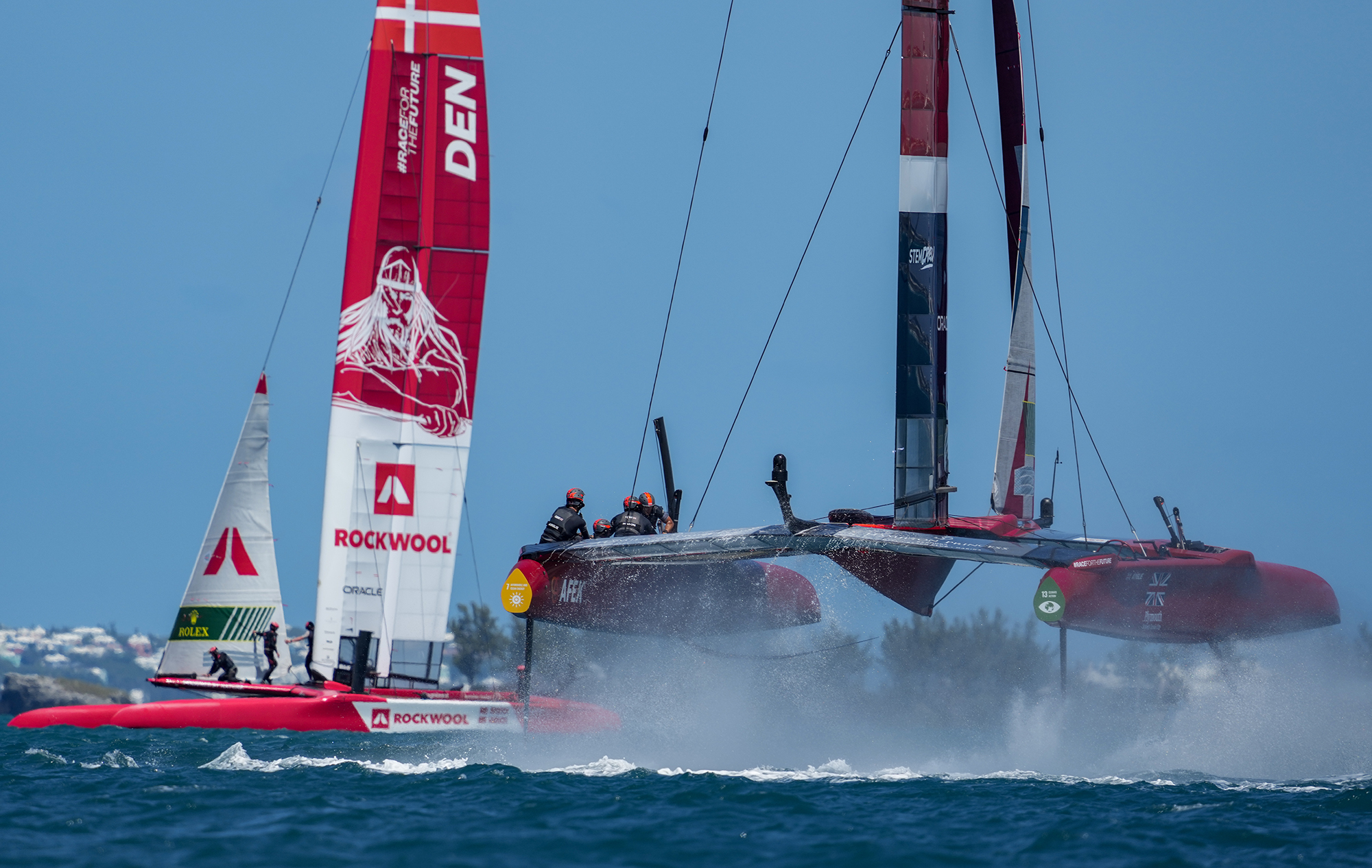 SailGP F50 catamarans foiling out of the water