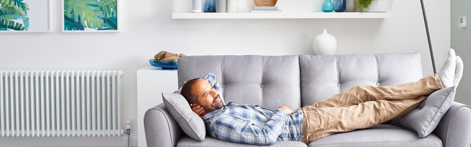 man relaxing with smart heating on