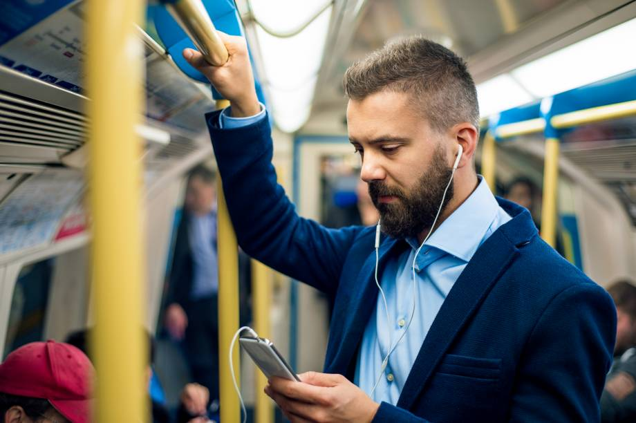 Picture of a commuter on their smartphone