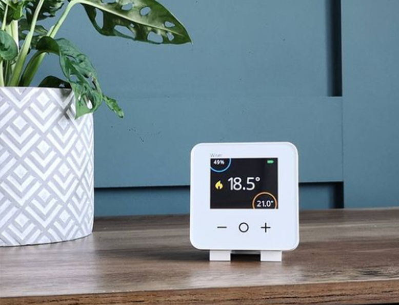 Wiser smart thermostat with stand on table
