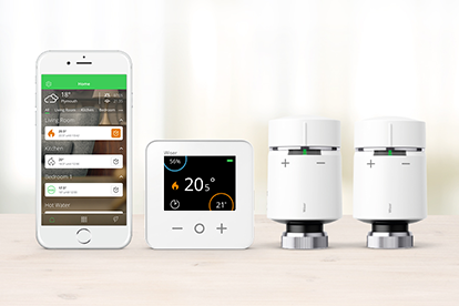 Wiser products on table including App, thermostat, and radiator thermostats